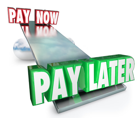 Pay Now Vs Later words on a see saw or balance to illustrate the choice and decision to borrow money or apply for credit to purchase goods or services
