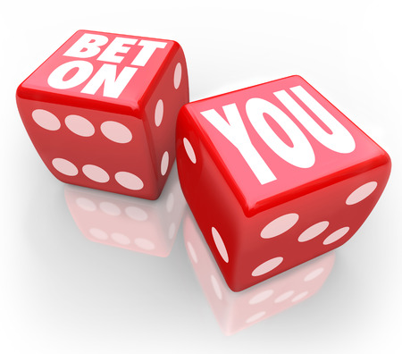risking: Bet On You words on two red dice to illustrate self confidence and following your dreams in career or life