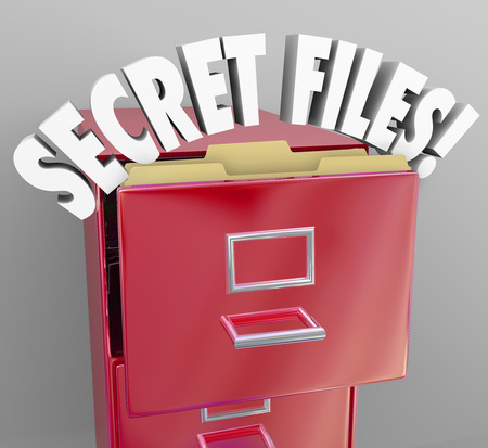 secret information: Secret Files words in a red filing cabinet to illusrate confidential, classified information stored away in archives Stock Photo