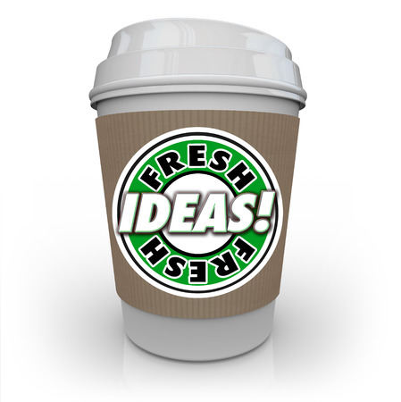 creativity: Fresh Ideas words on a coffee cup to illustrate new innovative concepts, inspiration, creativity and imagnination