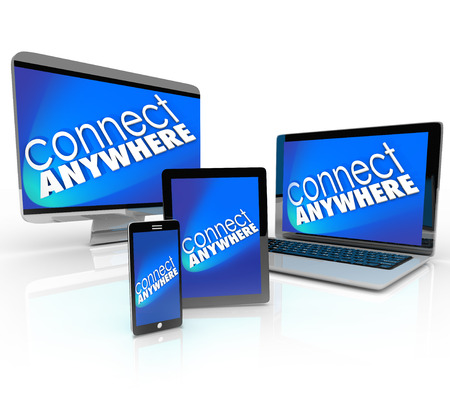 Connect Anywhere words on several computer devices -- laptop, desktop, smart phone and tablet -- to illustrate wireless connectivity over a wifi communication network