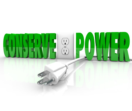 disconnection: Conserve Power words and electrical plug taken out of energy outlet to practice green conservation and preserve resources