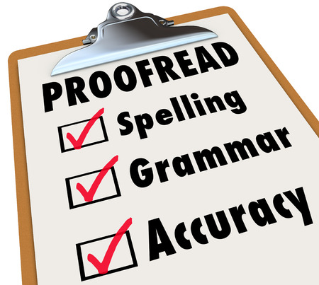 revising: Proofread checklist and checked boxes next to the words spelling, grammar and accuracy as the things an editor reviews in an essay, article or report Stock Photo