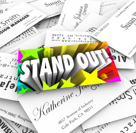Stand Out words and stars on business cards to illustrate being unique, special and different to catch attention among lots of competition