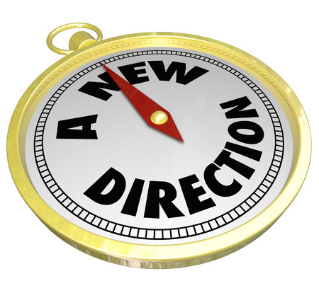 paradigma: A Nuevas palabras de direcci�n en un comp�s de oro para ilustrar la elecci�n de una ruta de acceso cambiada o camino a seguir en la vida, trabajo o carrera Foto de archivo