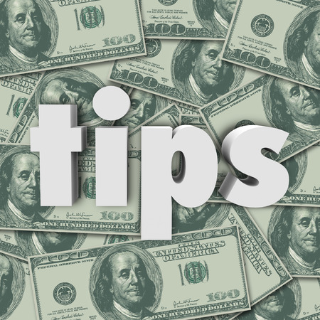 Tips word in white 3d letters on a background of hundred dollar bills in cash money as a bonus, thank you or appreciation of excellent service Banco de Imagens