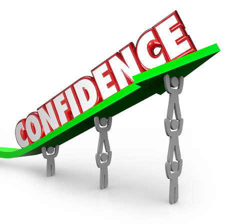 motivating: Confidence word lifted on arrow by team working together to be confident that success is achievable through collective effort