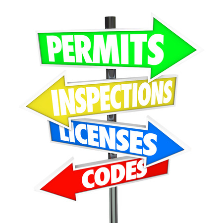 Permits, Inspections, Licenses and Codes words on colorful arrow road signs pointing you in the right direction on steps to build a home with new construction
