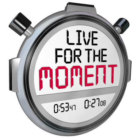 living moment: Live for the Moment words on a stopwatch or timer to illustrate a saying, motto, quote or phrase about the importance of enjoying your present time and the right now