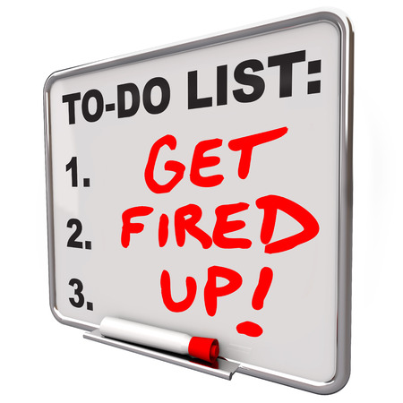 dry erase board: Get Fired Up and excited for a plan, mission or project with words as a message or reminder written on a dry erase board with red pen or marker