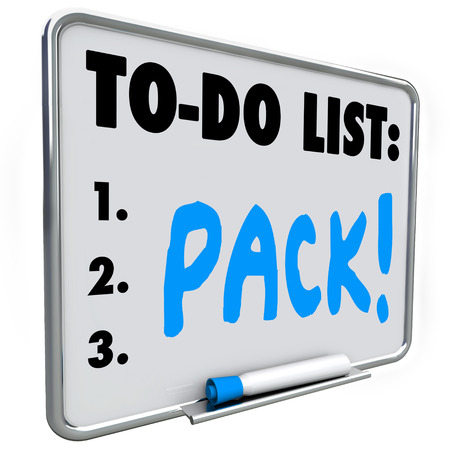 anticipating: Pack word on a to-do list written on a dry erase board to remind you to prepare in packing your blongings for a move or vacation trip Stock Photo