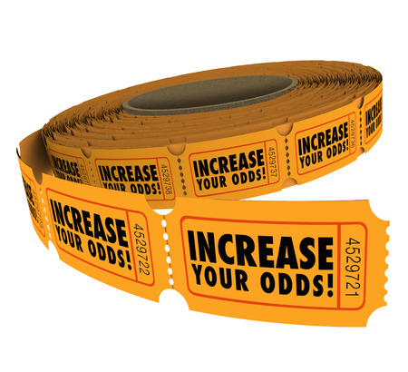 Increase Your Odds words on a roll of raffle or lottery tickets, encouraging you to buy more to enter the drawing to win cash or prizes Stock Photo