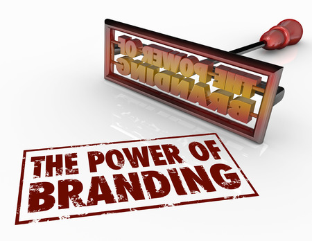 The Power of Branding words and a brand iron to illustrate trust, loyalty, identity and marketing awareness Standard-Bild