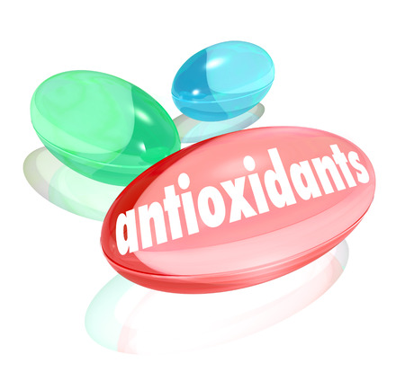 nutritional: Antioxidants words on capusles or pills to symbolize nutritional supplements with natural ingredients for a healthy lifestyle