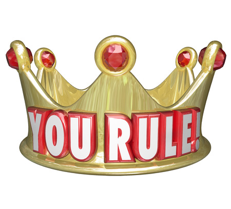 commend: You Rule words on a gold crown as praise or recognition for a job well done, or symolizing the king, queen or monarch of a land Stock Photo