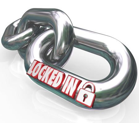 contractual: Locked In words on metal chain links to illustrate a commitment or contractual obligation you have with another person or company Stock Photo