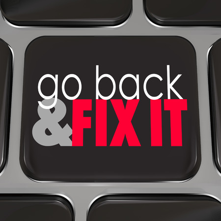 correcting: Go Back and Fix It words on a black computer keyboard key to symbolize a program, software or application that helps you correct mistakes or errors