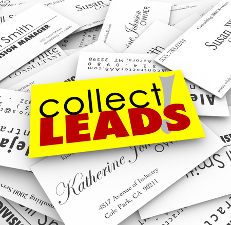 pile up: Collect Leads words on a pile of business cards from new customers and prospects for your growing company