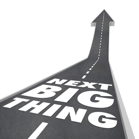 Next Big Thing words on a street or road with arrow pointing up to predict a new trend, fad or craze  Stock Photo - 29799315