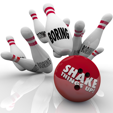 dullness: Shake Things Up words on a bowling ball striking pins marked bowling as an exciting idea ending dullness and sameness Stock Photo