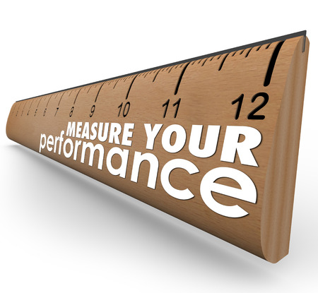 benchmarking: Measure Your Performance words on a wooden ruler, evaluating your work quality, skills or knowledge at a job or school Stock Photo