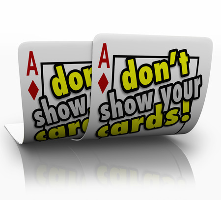 Dont Show Your Cards words on a pair of aces kept secret from your competition and negotiating partner so you get the best deal possible