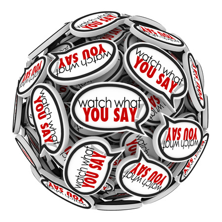 Watch What You Say words in speech bubbles or clouds to remind you to be careful with sensitive or offensive language and be politically correct photo