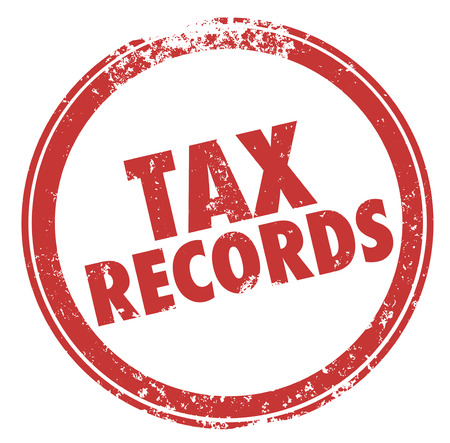 personal record: Tax Records words in a round red ink stamp to illustrate the need to keep files in case of an audit of your finances Stock Photo