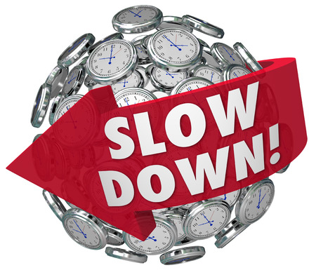 slow: Slow Down words on a ball or sphere of clocks warning you to go slower to avoid danger, hazards or risks from being too quick or fast in driving, running, or passing through time Stock Photo