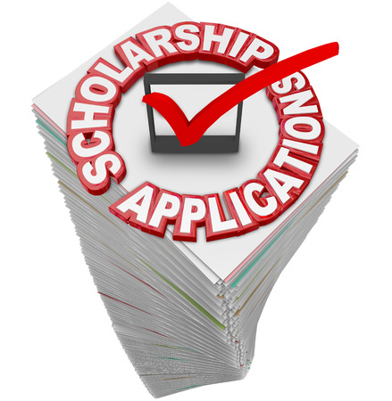 honorarium: Scholarship Applications paperwork stack for you to fill out and apply for merit awards and financial support for a college or university or other school of higher learning Stock Photo