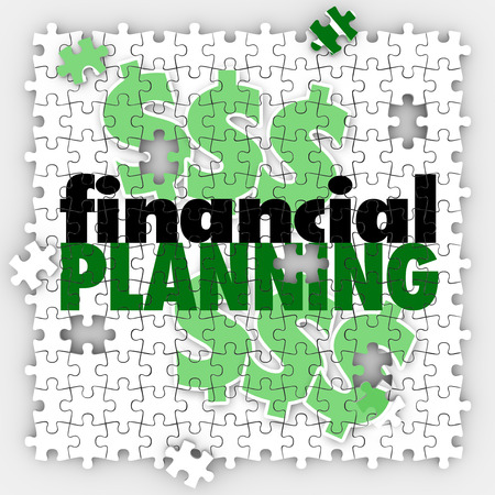retirement savings: Financial Planning words on puzzle pieces to illustrate finishing or completing your budget or retirement savings goal or objective