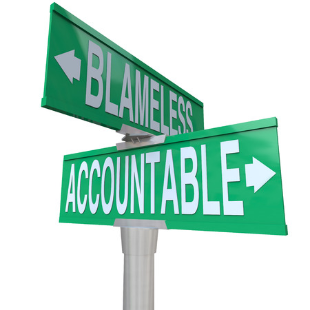 company ownership: Accountable and Blameless words on two green road or street signs at an intersection showing the choice between taking or shirking responsibility