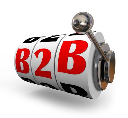b2b: B2B letras en los diales de m�quinas tragamonedas o ruedas como los juegos de azar o de apuestas sobre las ventas del negocio de una compa��a a otra Foto de archivo