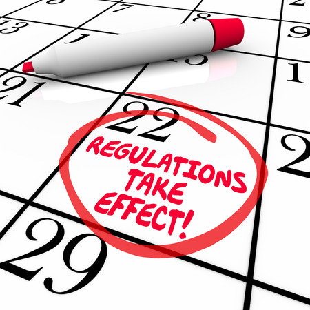 regulating: Regulations Take Effect words on a calendar with day or date circled to remind you to meet improtant rules or codes to be in compliance