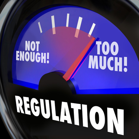regulating: Regulations gauge measuring the amount of regulatory activity in an indsutry, with needle rising from not enough to too much Stock Photo