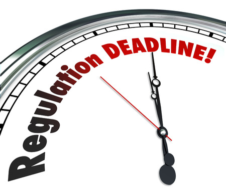 reminding: Regulation Deadline words on a white clock face reminding you it is time to meet, follow or comply with important rules, guidelines and laws