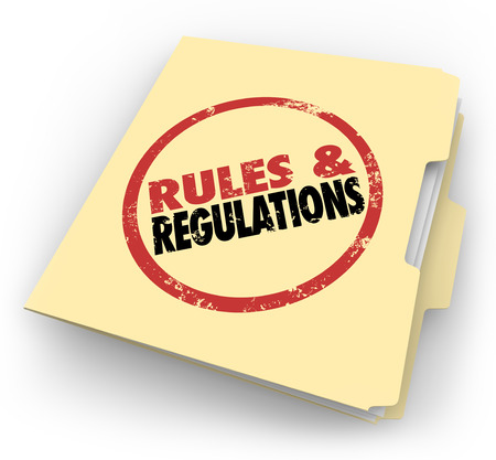 government regulations: Rules and Regulations stamped on a manila folder of documents or files outlining laws or guidelines you must follow at work or in your career