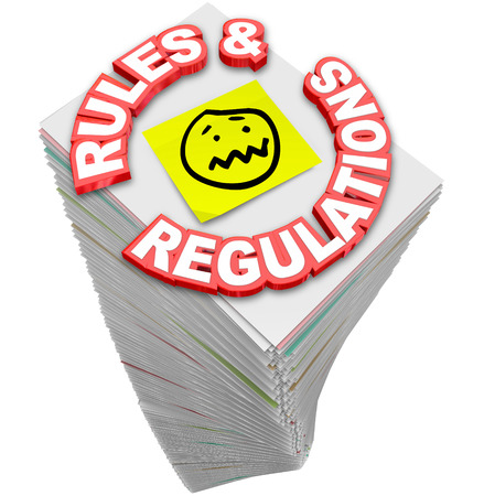 regulating: Rules and Regulations words in red 3d letters on a stack of paperwork, guidelines, codes, laws and standards you must follow in your business or finances