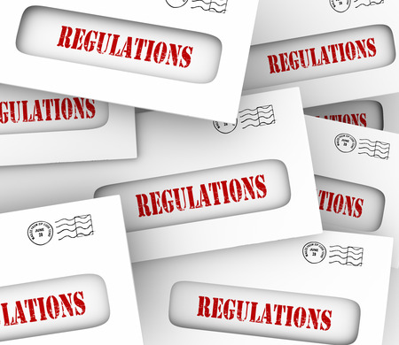 regulated: Pile of envelopes with word Regulated as official notifications overseeing your business, home, career or life Stock Photo