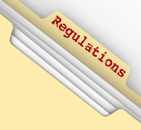 government regulations: Regulations word on the tab of a manila file folder containing documents of laws, guidelines, rules and standards you must adhere to