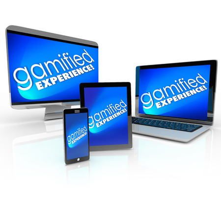 Gamified Experience words on a computer desktop, laptop, tablet and smart phone promoting gamification education or marketing campaigns Stock Photo - 30365950