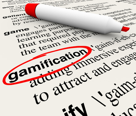 Gamification word circled on a dictionary page with the definition educating you on the term gamify as a way to educate customers and students by making learning or marketing fun photo