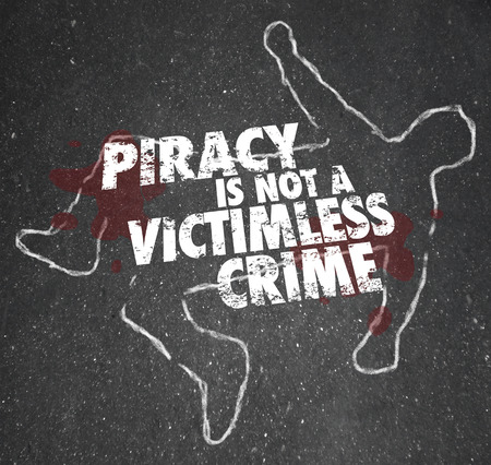 Piracy is Not a Victimless Crime words on a chalk outline of a dead body and blood on the pavement photo
