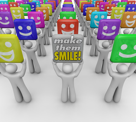 spread the word: Make Them Smile words held by a person with a sign spreading good cheer and moods with laughter, humor and kindness