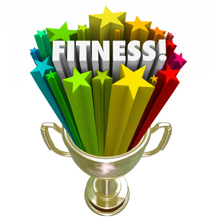 Fitness word in a gold trophy surrounded by stars celebrating your great score or results in a competition of wellness and healthy lifestyle living