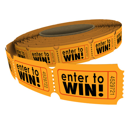win win: Enter to Win words on a roll of orange raffle or lotter tickets as a fundraiser for charity or contest for lucky players