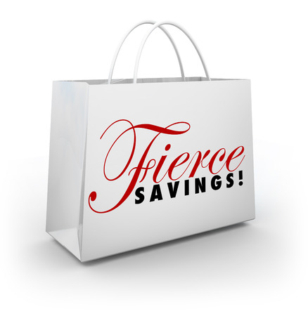 Fierce Savings words on a shopping bag advertising a huge sale or discount clearance event Stock Photo - 30615859