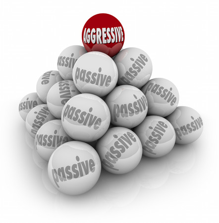 contentious: Aggressive word on red ball on top of pyramid of spheres marked Passive illustrating success achieved by the bold and determined in life or career Stock Photo