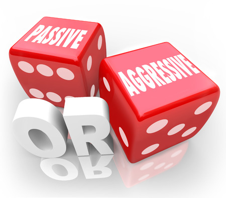 opposites: Passive or Aggressive words on two 3d red dice illustrating contrast in opposites of bold or meek action or behavior