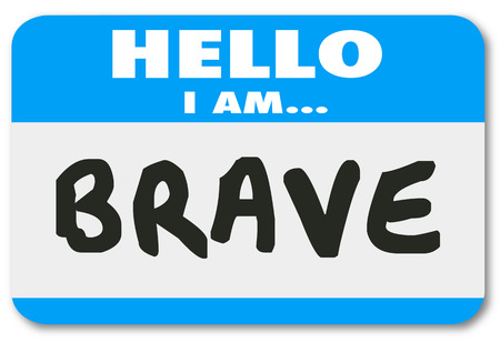 am: Hello I am Brave words on a blue name tag or sticker announcing you are courageous, bold, daring and confident to handle the job or career Stock Photo